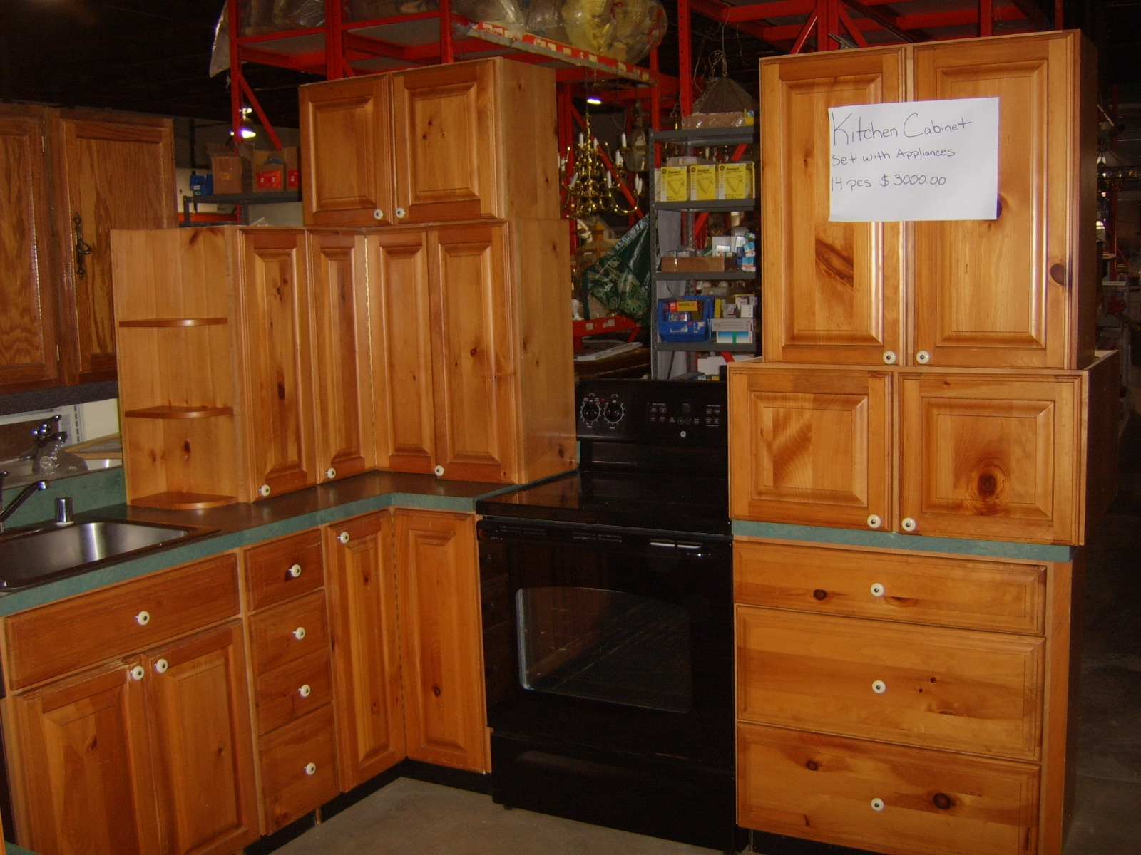 Staring into the light pine kitchen cabinets and appliances for sale