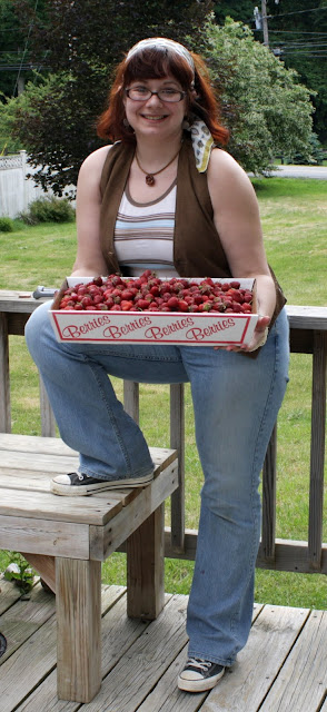 vest, tank top, flared jeans, tray of strawberries