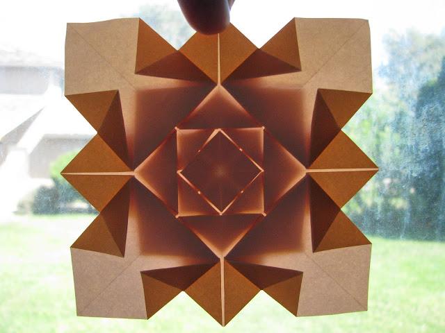 Shuzo Fujimoto Orange 5-layer Hydrangea Tessellation window lit front
