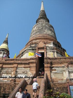 climbing the staircase of Ayutthaya city ruins