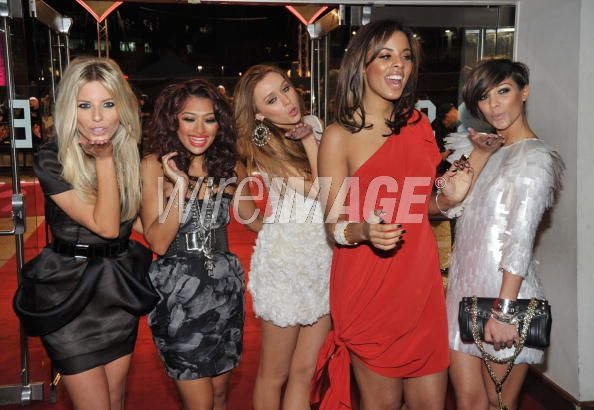 The Saturdays wearing my SS2010 collection. black dress far left and white ruffle center