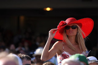 Woman in Bright Red Kentucky Derby Hat