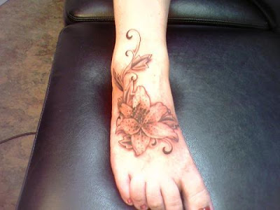 Sample Tattoos - Flower tattoo on foot