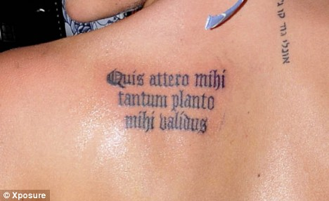 Lady Gaga shows off new German quote tattoo while on tour. German? tribal