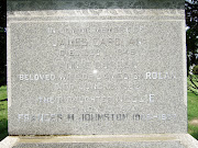 Closeup of the tombstone of James Carolan and Annie Curran.