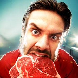 wild animal eating raw meat