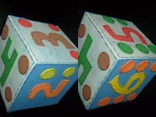 Dado feito com caixinhas de leite e forradas com E.V.A
