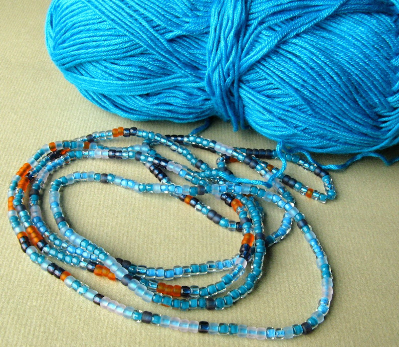 Beads strung on yarn