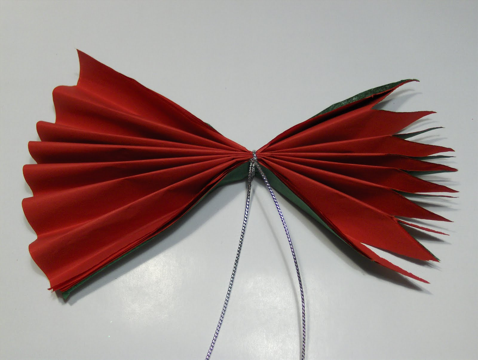 The essential packaging store blog tissue paper poinsettia flowers trim the ends of the folded tissue paper by cutting the ends into points mightylinksfo