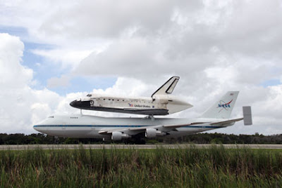 One of NASA's 747 Shuttle Carrier Aircraft touches down Monday at Kennedy Space Center in Florida