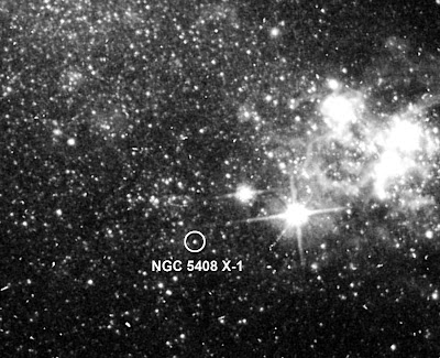 This archival image taken by the Hubble Space Telescope shows the location of NGC 5408's unusually luminous Xray source