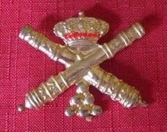 Emblema artillero de la boina.