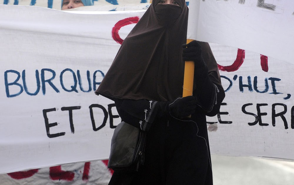 behind the burqa essay It is true that some women freely decide to wear the niqab because they  to  enter the mosque from the side and 'free' to stand behind the men.