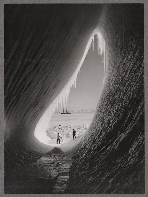 Grotto in an iceberg, photographed during the British Antarctic Expedition of 1911-1913, 5 Jan 1911. Photographer: Herbert Ponting. Silver gelatin print. Photographic Archive, Alexander Turnbull Library.
