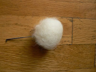 Needle felting a white wool roving Halloween ghost