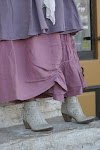 Detail of Completo linen dress, skirt and boots