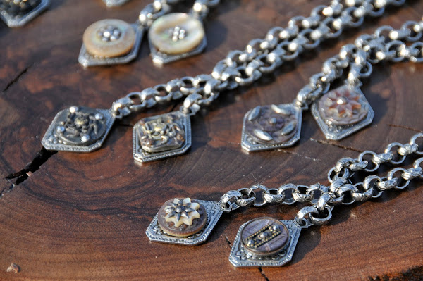 Lariat necklaces with two vintage buttons.  Gold or silver finishes.