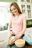 woman slicing cantaloupe