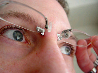 ... of eyeglasses that mounts into the bridge of your nose, via piercing