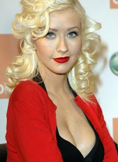 Christina Aguilera plans more babies to keep her breast pumped