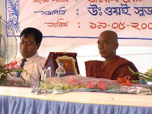 Mr. Mizanur Rahman, Deputy Commissioner and U. Wee Su Dha Mohathero, Cheif Petron of Sanghamitta Se