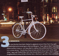 Picture of a completely white bike (tires and all) pictured chained to a signpost in New York City. There are 41 of these
