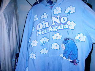 a blue hooded sweatshit with Eeyore on it and it says Oh no not again!!