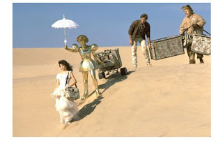 Scene from Spaceballs where they're walking across the desert with her royal highness's matched luggage