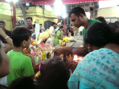 Performing aarti Ganesh Visarjan