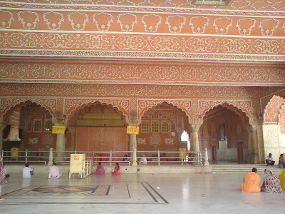 Finely carved ceilings and walls of the Govind Devji Temple in Jaipur