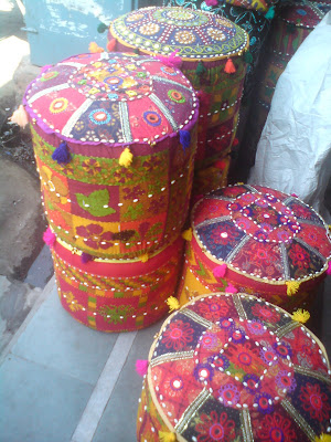 Colorful seats known as moodas - Shopping in Jaipur
