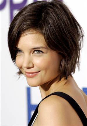 It helps that Katie Holmes has a cute face to go along with it.