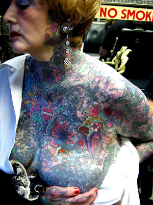 Above and Below is the Tattooed Lady. Cousins Pick Money Shoes and Tattooed