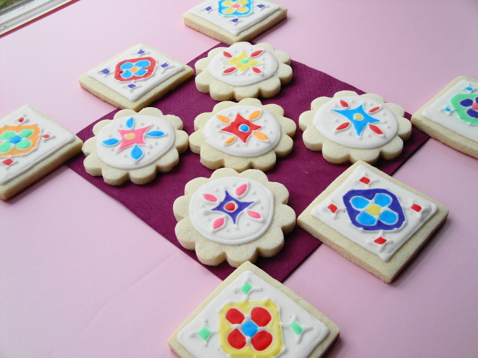 cumin and cardamom rangoli decorated sugar cookies