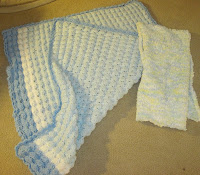 crocheted baby blanket and scarf