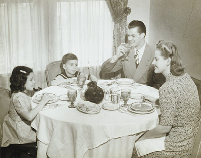 1950s family eating dinner