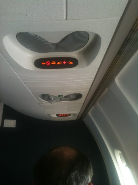 airplane seat belt sign. Yet, the seatbelt sign is on