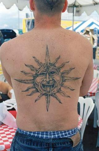 It's a pretty close rendition of Charisma's sun tattoo.