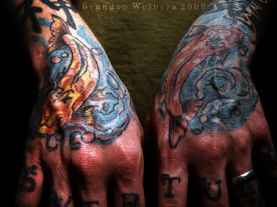 Hands Tattoo Design. The Tattoo on Right Hand more coloured