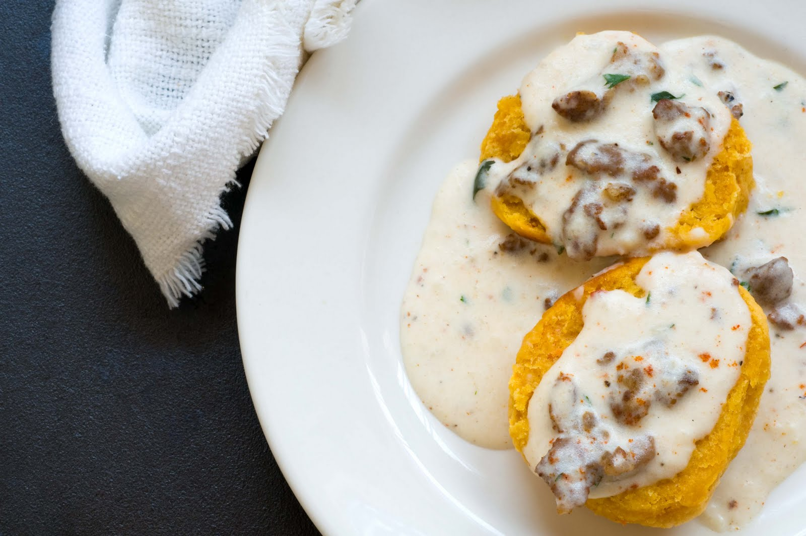 Please enjoy these sweet potato biscuits and the chorizo gravy. And ...