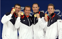 U.S. Olympic Swimmers Michael Phelps, Brendan Hansen, Jason Lezak and Aaron Peirsol Hold Up Their Gold Medals From The Men's 4x100 Medley Relay