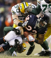Monday Night Football - December 22, 2008 - Green Bay Packers at Chicago Bears - Bears RB Matt Forte Runs Into Green Bay Defenders Aaron Kampman and A.J. Hawk