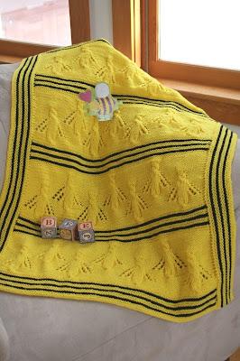 http://tashaknits.blogspot.com/2011/01/buzzy-bee-baby-blanket.html