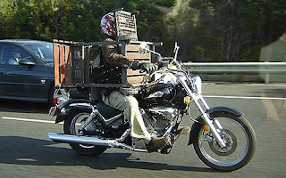 Michael Wiles driving with his barbecue grill strapped on