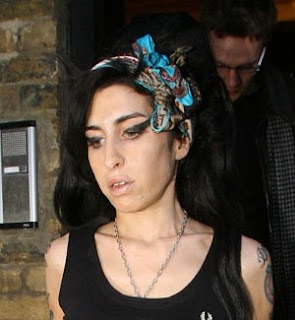 Amy Winehouse cautioned