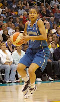 Minnesota Lynx player shooting the ball on the court at the Target Center