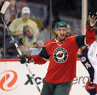 Cal Clutterbuck celebrating at the Xcel