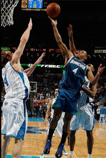 Minnesota Timberwolves Player dunking the ball