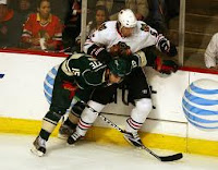 Andrew Brunette and a Chicago Blackhawk player tangled up