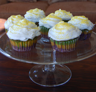 Mardi Gras striped cupcake on cake stand